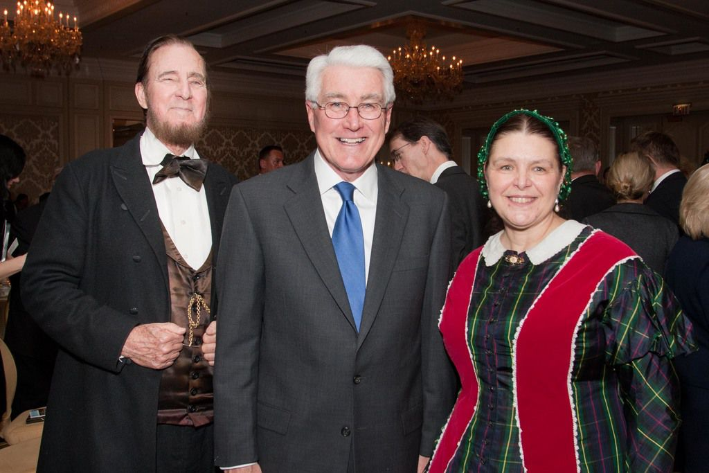 Former Illinois Gov. Jim Edgar with actors playing Abraham and Mary Todd Lincoln at the Abraham Lincoln Leadership Prize dinner on February 9, 2012.