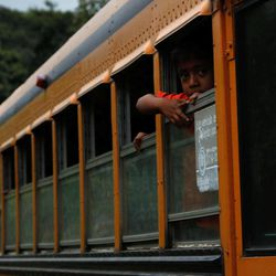 A boy peers from the window of a government provided bus during evacuations away from the Volcan del Fuego, or Volcano of Fire, to a shelter as they leave the village of Morelia, Guatemala, Thursday, Sept. 13, 2012. The long-simmering volcano exploded with a series of powerful eruptions outside one of Guatemala's most famous tourist attractions on Thursday, hurling thick clouds of ash in the air and spewing rivers of lava down its flanks.