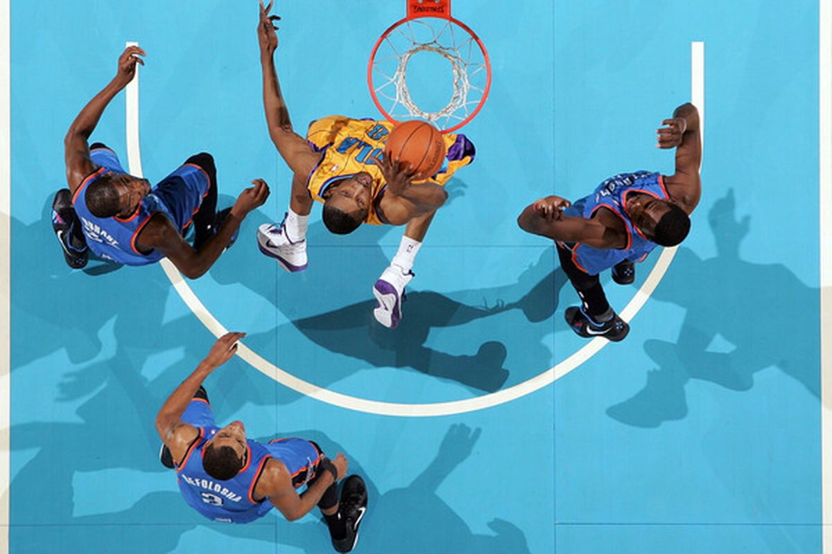 A sea of blue cannot block the hammer of D.J. Mbenga, but the rim itself sure can!
