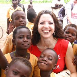 Empowering Nations volunteer Sarah CarMicheal Parson is surrounded by village children in Ghana, Africa.