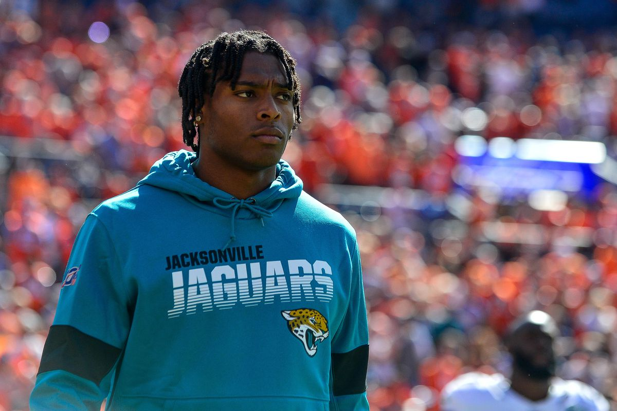 Jalen Ramsey of the Jacksonville Jaguars walks onto the field in street clothes before a game against the Denver Broncos at Empower Field at Mile High on September 29, 2019 in Denver, Colorado.