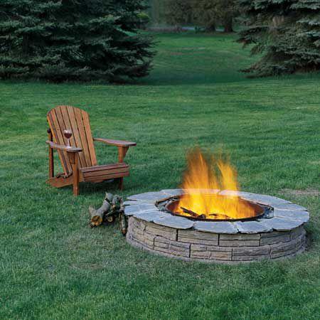Round fire pit on grass.
