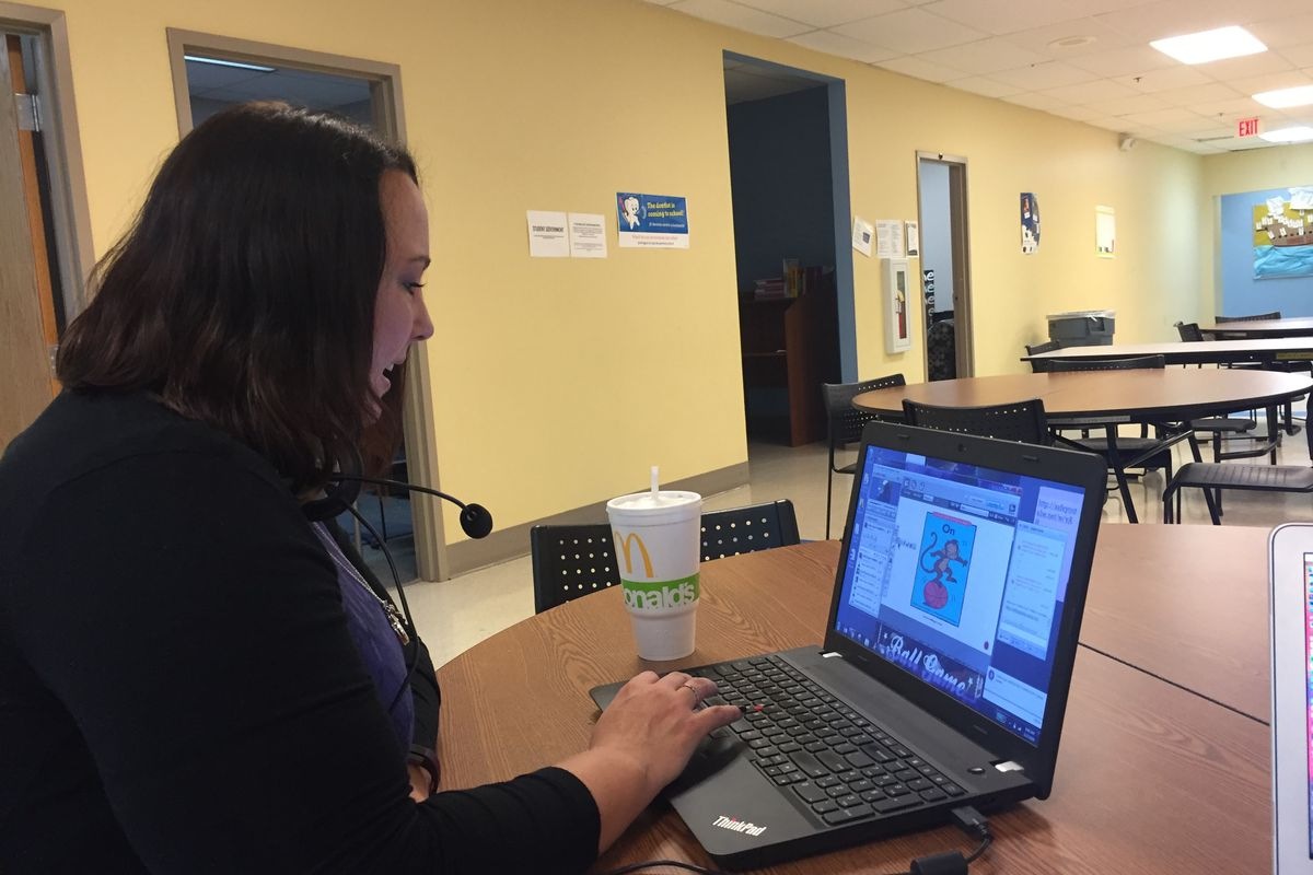 Kindergarten teacher Alyssa Davis leads a reading lesson at Hoosier Academy's building in Marion County.