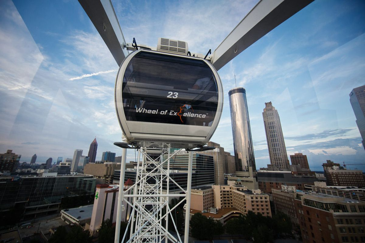 An enclosed gondola at the apex of a revolution.