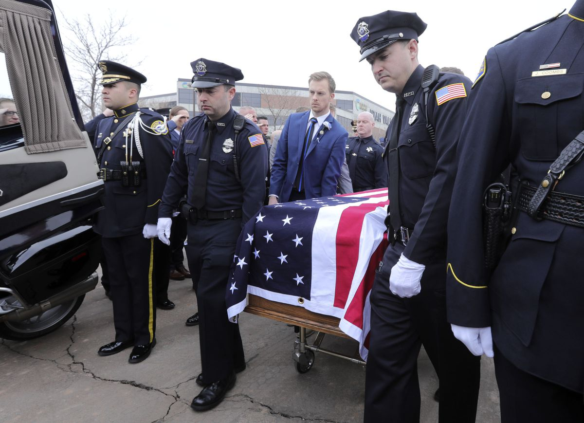 Pallbearers load the casket of slain Provo police officer Joseph Shinners into a hearse outside the UCCU Center following Shinners' funeral in Orem on Saturday, Jan. 12, 2019.