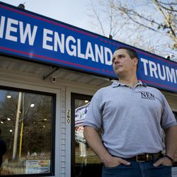 Rhode Island entrepreneur Keith Lambert poses for a portrait outside of his store that sells Donald Trump merchandise in Bellingham, Mass., Saturday, Nov. 9, 2019.
