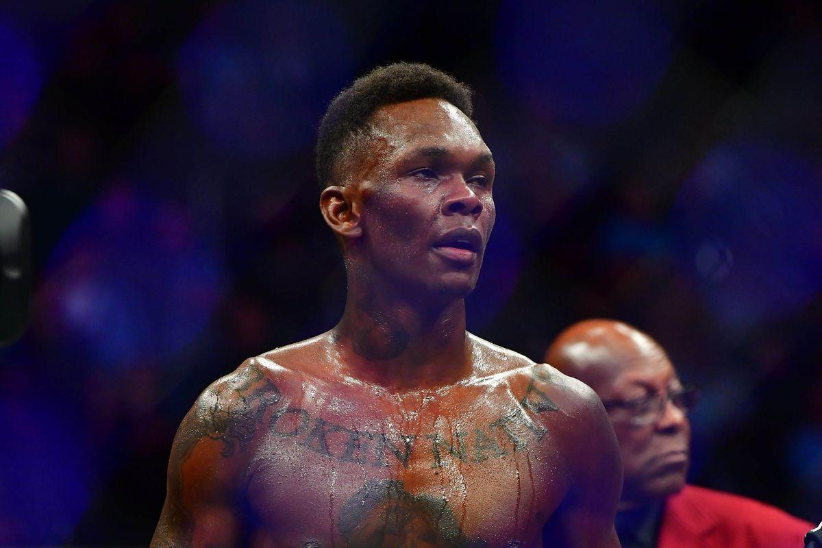 Israel Adesanya celebrates beating Yoel Romero during UFC 248 at T-Mobile Arena.