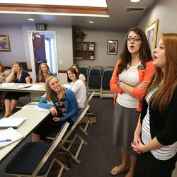 Sister Molly Fields, left, from Portland, Ore., and Sister Rebekah Pence, from Buena Vista, Va., sing a song they composed as sister missionaries gather at a training meeting for the Nevada Las Vegas Mission Friday, March 14, 2014, in Las Vegas.