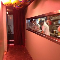 Diners get a view of the kitchen on the way to the dining room.