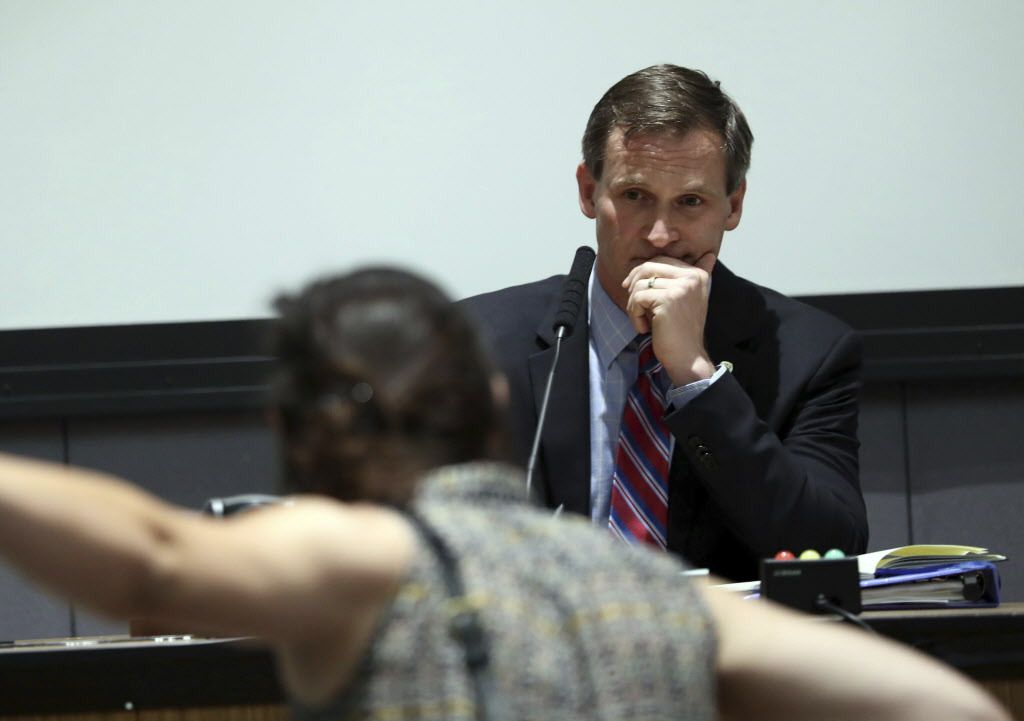 A protester yells as Mayor Mike Signer listens during the Charlottesville City Council meeting on Monday. | Andrew Shurtleff/The Daily Progress via AP