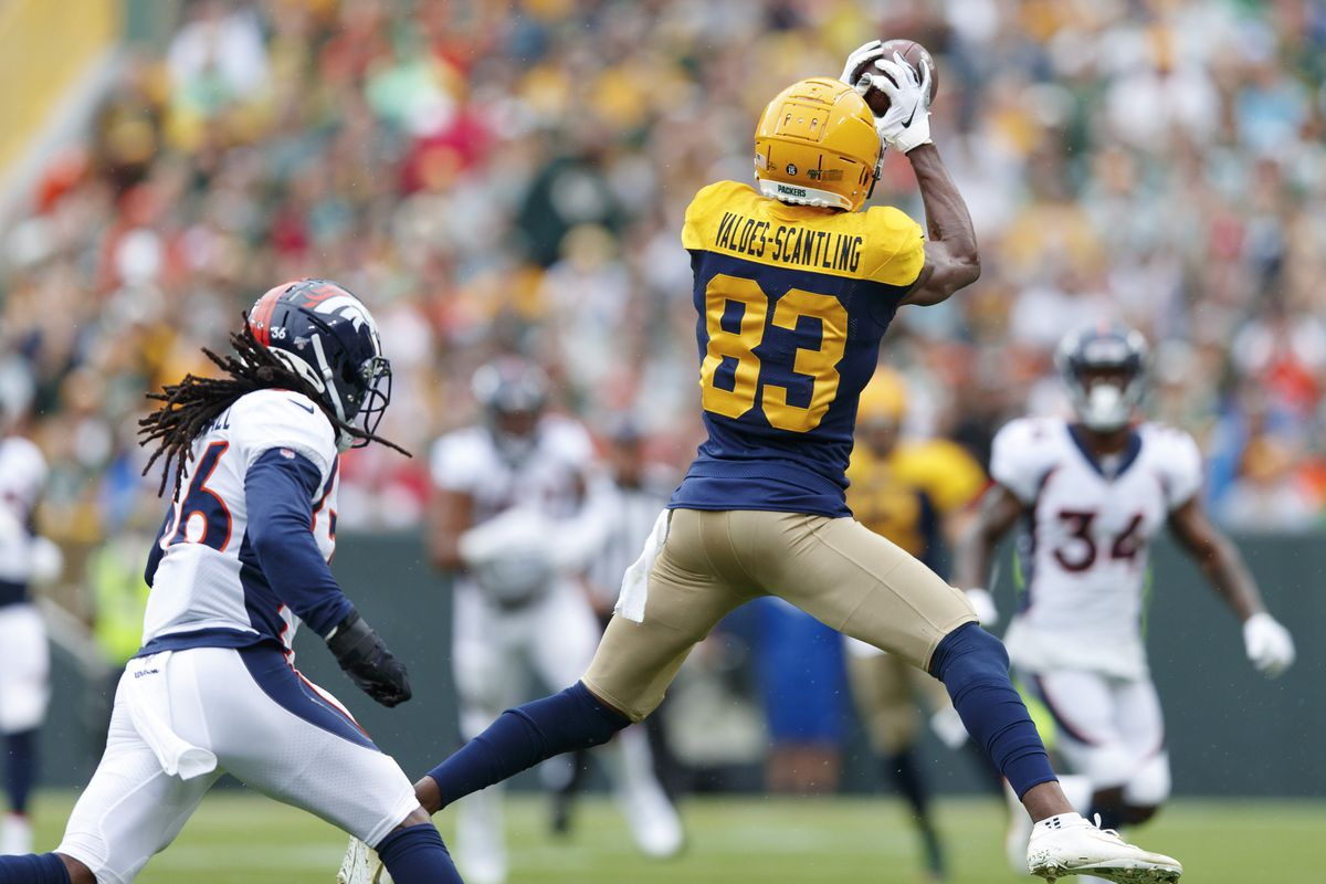 Green Bay Packers wide receiver Marquez Valdes-Scantling catches a pass in front of Denver Broncos safety Trey Marshall during the first quarter at Lambeau Field.