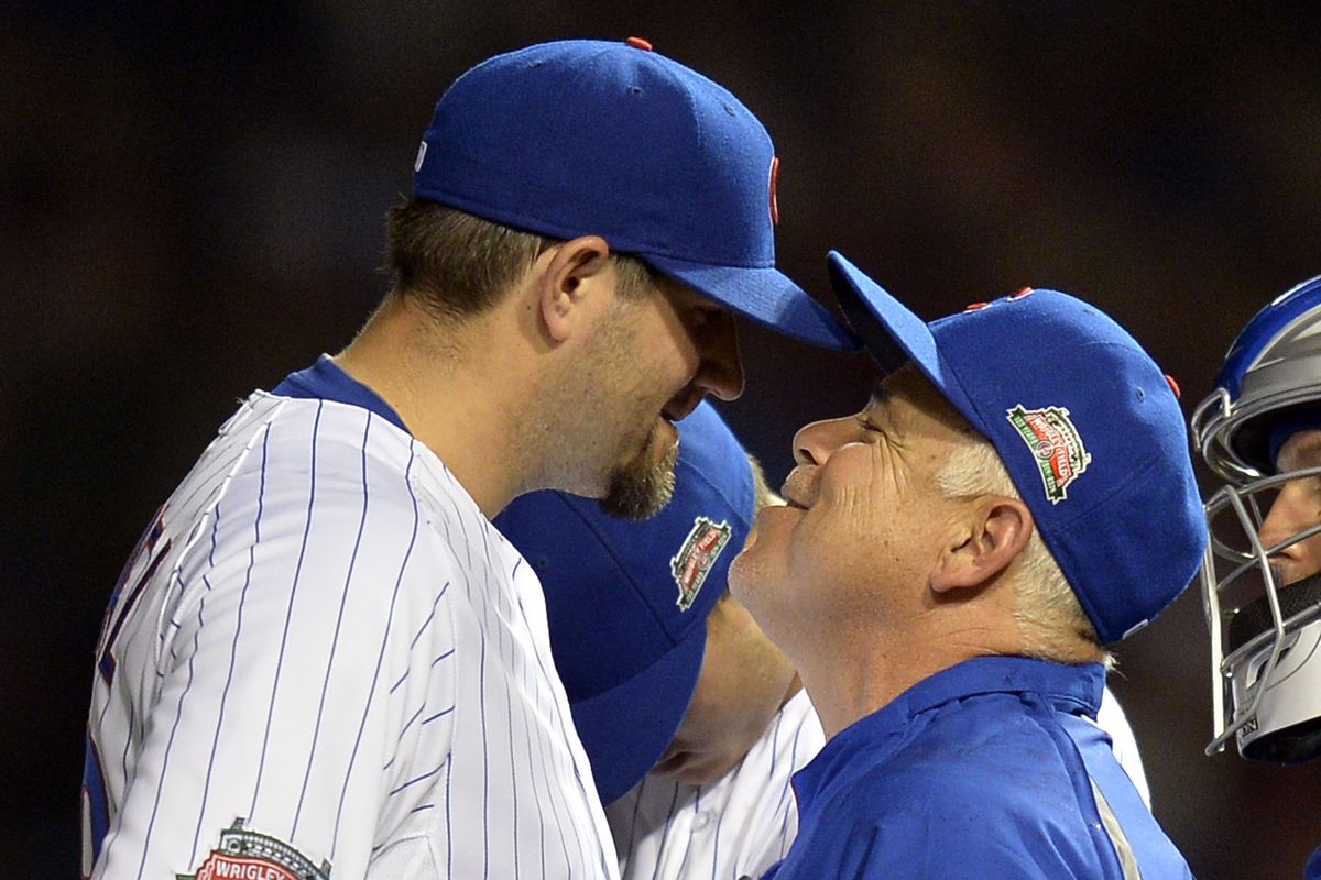 Anthony Rizzo can't seem to bring himself to look at the scene playing out in front of him.