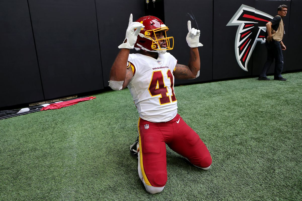 J.D. McKissic #41 of the Washington Football Team reacts after scoring a touchdown during the fourth quarter in the game against the Atlanta Falcons at Mercedes-Benz Stadium on October 03, 2021 in Atlanta, Georgia.