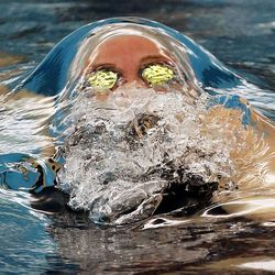 Rhyan White, of Cottonwood, competes in the 100-yard backstroke during the 5A state high school swimming championships in Provo on Friday, Feb. 10, 2017.