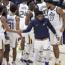 Utah Jazz guard Donovan Mitchell (45) high-fives his teammates after an NBA preseason game against the New Orleans Pelicans at Vivint Arena in Salt Lake City on Monday, Oct. 11, 2021. The Jazz won 127-96.