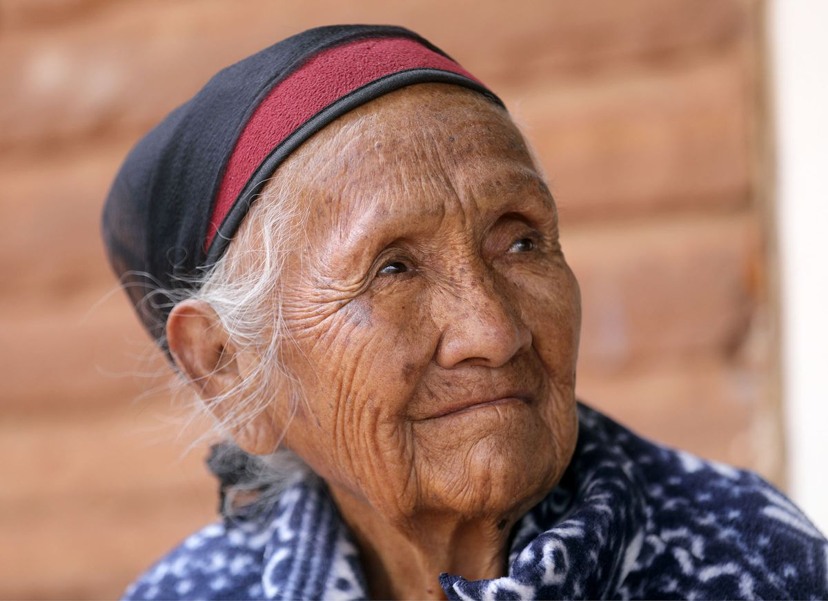 Ruth Holiday, 84, sits outside of her home in Oljato-Monument Valley, San Juan County, on Thursday, April 30, 2020. A sign hangs on the door of her home notifying visitors not to enter because her husband has a respiratory illness. TheNavajo Nation has one of the highest per capita COVID-19 infection rates in the country.