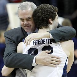 BYU head coach Jim Rose hugs BYU guard Jimmer Fredette (32) after the game as BYU defeated Gonzaga Saturday, March 19, 2011, in the third round of the NCAA Tournament at the Pepsi Center in Denver, Colorado.