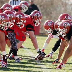 University of Utah football players practice on the opening day of spring football in Salt Lake City Tuesday, March 19, 2013.
