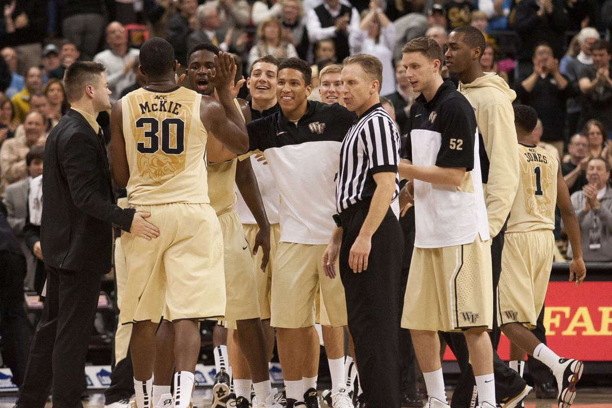 A happy bench greets senior Travis McKie after he hits a 3-pointer in the 2nd half of Wake's 73-67 victory Sunday night