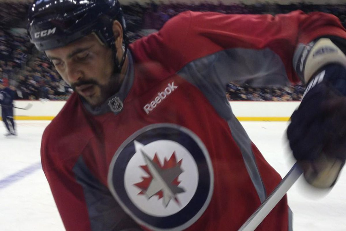 January 13, 2013 - Dustin Byfuglien takes part in day one of Winnipeg Jets' training camp