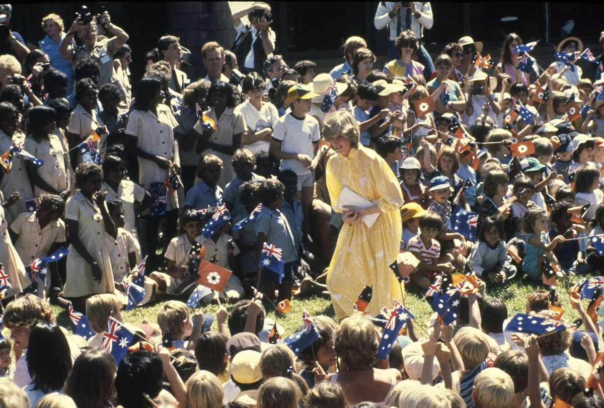 In this March 21, 1983 file photo, Diana, Princess of Wales is pictured amid a large group of schoolchildren during her visit to Alice Springs, Australia.