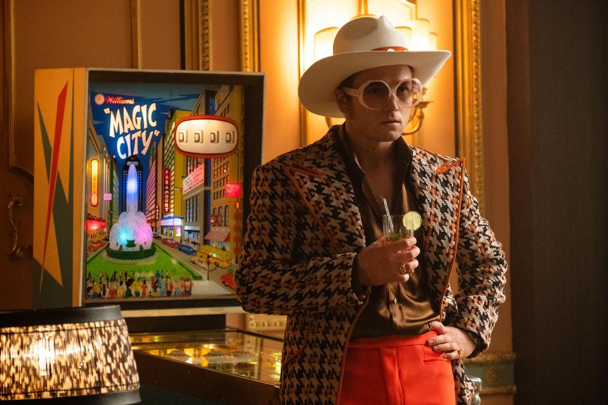 Taron Egerton as Elton John, sporting one of the singer's more colorful looks.