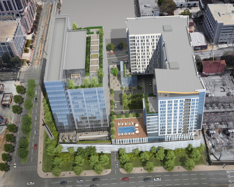 Another overhead rendering shows how the residential component's pool would sit elevated between the two towers.