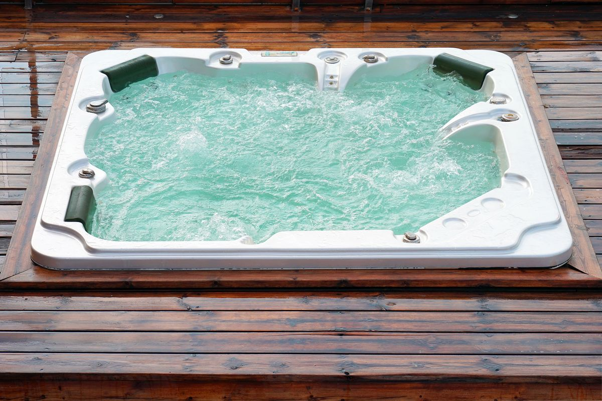 Hot tub on wood deck.