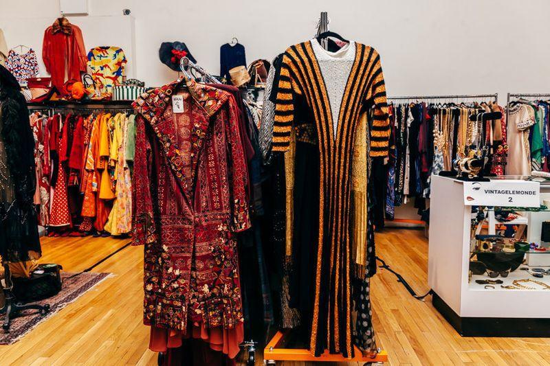 Vintage dresses on mannequins and clothing racks inside the Manhattan Vintage Show