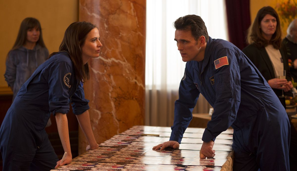 Eva Green and Matt Dillon face each other over a table in Proxima
