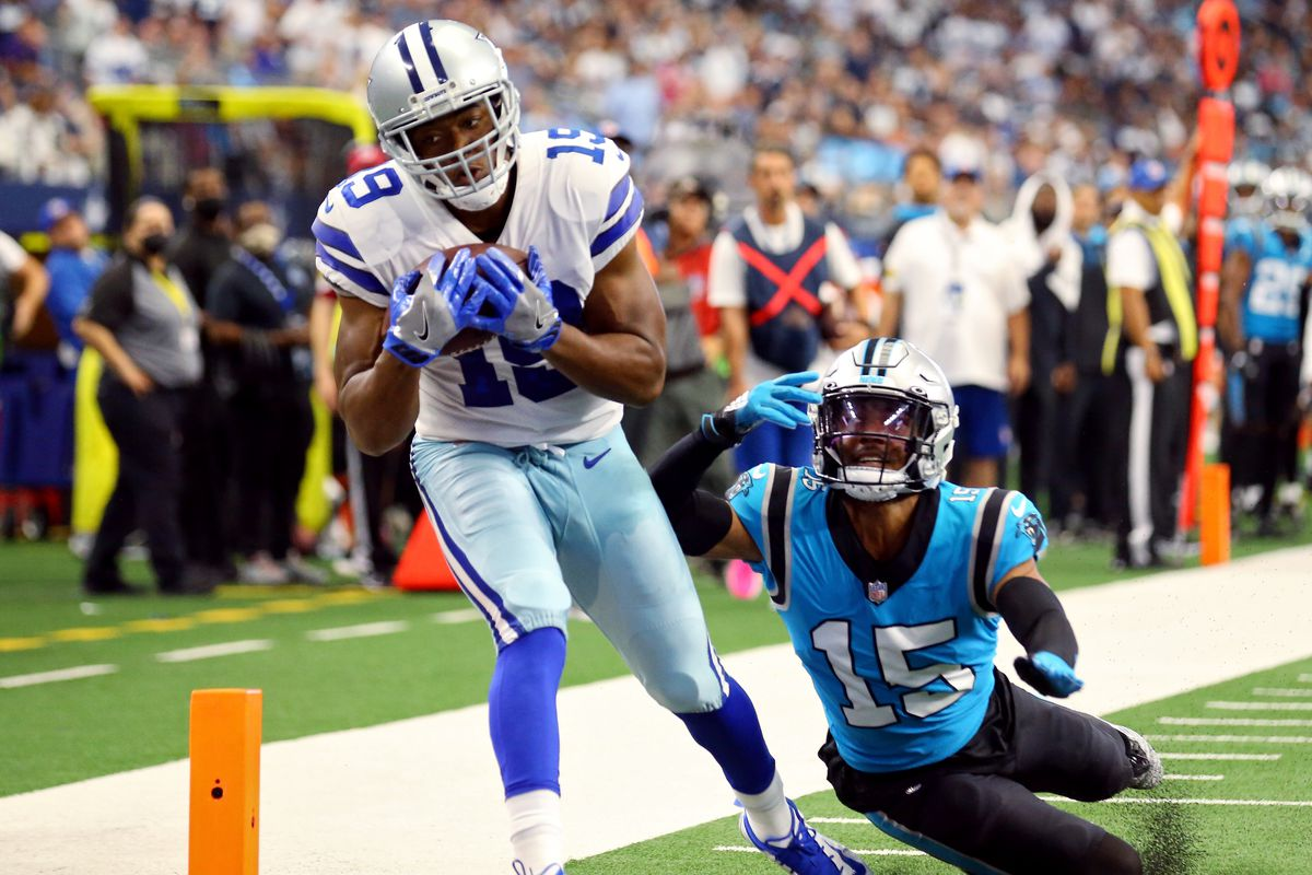 Amari Cooper #19 of the Dallas Cowboys catches the ball for a touchdown during the third quarter against the Carolina Panthers at AT&T Stadium on October 03, 2021 in Arlington, Texas.