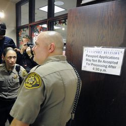 A Salt Lake County sheriff's deputy closes the county clerk's door for the night as many came to receive their marriage license after a federal judge ruled that Amendment 3, Utah's same-sex marriage ban, is unconstitutional on Friday, Dec. 20, 2013.