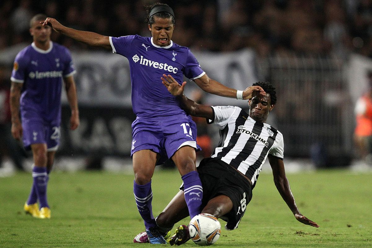 THESSALONIKI, GREECE - SEPTEMBER 15:  Lino of PAOK slides into Giovani dos Santos of Tottenham during the UEFA Europa League group A match between PAOK FC and Tottenham Hotspur at Toumpa Stadium on September 15, 2011 in Thessaloniki, Greece.