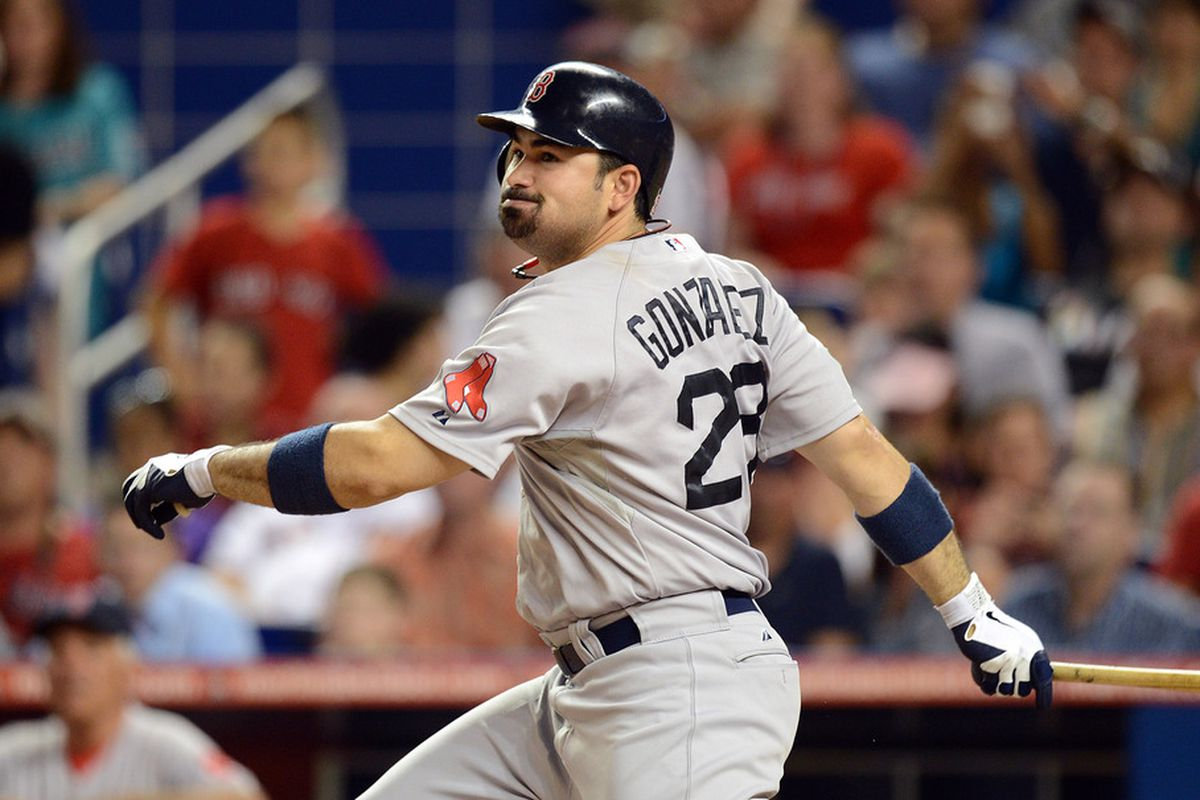 June 13, 2012; Miami, FL, USA; Boston Red Sox first baseman Adrian Gonzalez (28) connects for an RBI single during the eighth inning against the Miami Marlins at Marlins Park. Mandatory Credit: Steve Mitchell-US PRESSWIRE