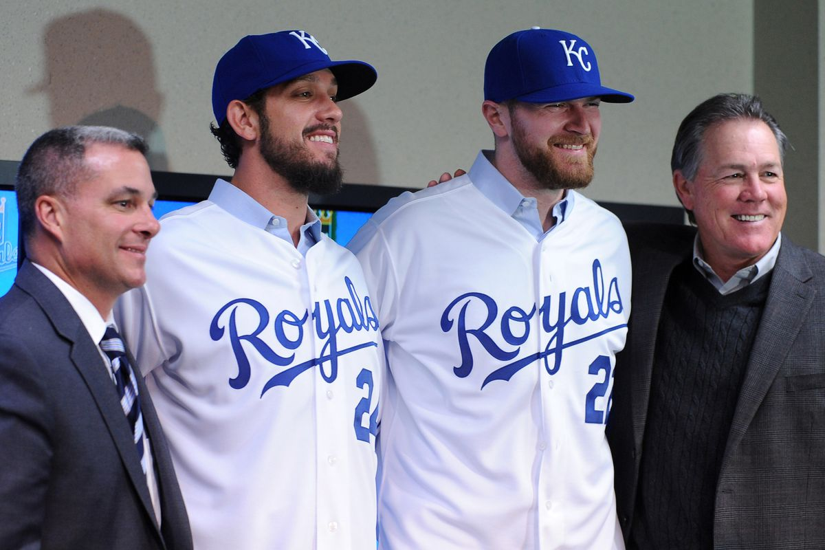 December 12, 2012; Kansas City, MO, USA; Kansas City Royals general manager Dayton Moore (left to right), newly acquired pitchers James Shields and Wade Davis, and manager Ned Yoast pose for photos after the press conference at Kauffman Stadium.