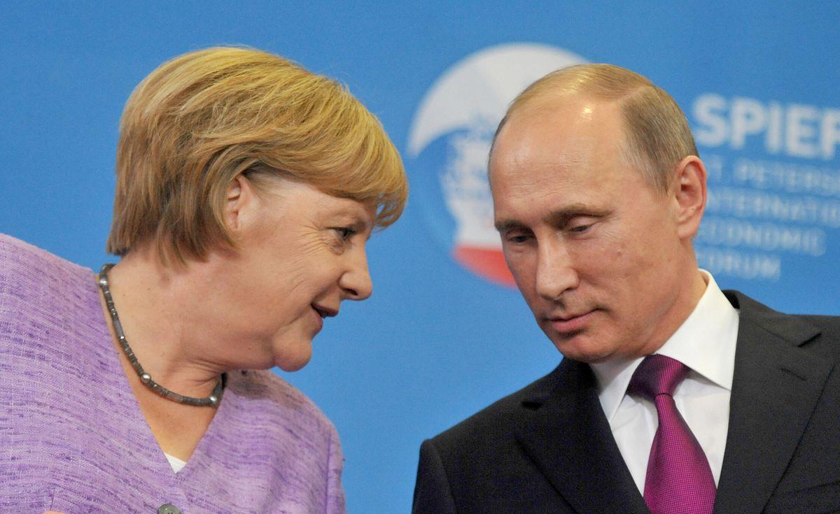 German Chancellor Angela Merkel and Russian President Vladimir Putin in Saint Petersburg in 2013 (OLGA MALTSEVA/AFP/Getty)
