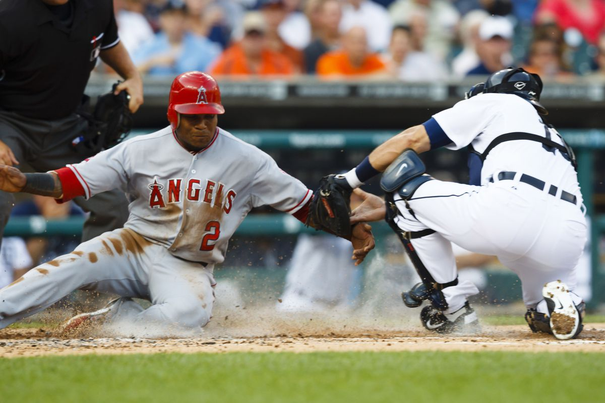 July 16, 2012; Detroit, MI, USA; Los Angeles Angels shortstop Erick Aybar (2) is tagged out at home by Detroit Tigers catcher Alex Avila (13) during the third inning at Comerica Park. Mandatory Credit: Rick Osentoski-US PRESSWIRE
