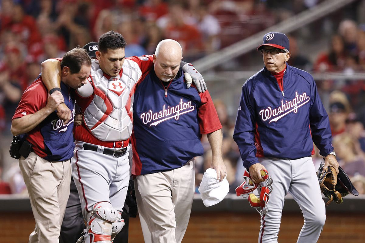 Manager Davey Johnson of the Washington Nationals looks on as catcher Wilson Ramos is helped off the field after suffering an injury against the Cincinnati Reds. (Photo by Joe Robbins/Getty Images)