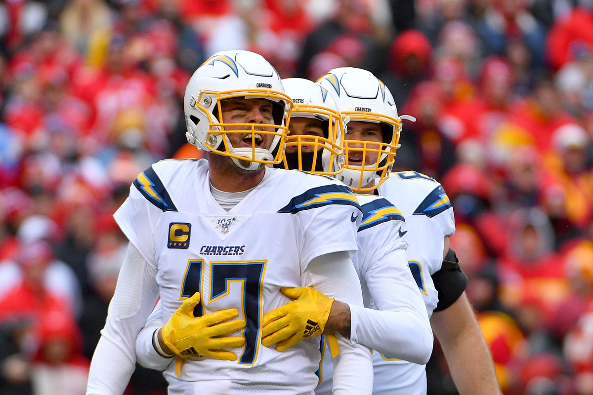Los Angeles Chargers quarterback Philip Rivers is restrained by wide receiver Keenan Allen after a play during the first half against the Kansas City Chiefs at Arrowhead Stadium.