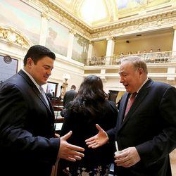 Juan Carlos Escamilla and Sen. Jim Dabakis, D-Salt Lake City,  greet one another at the first day of the Utah Legislature at the Capitol in Salt Lake City on Monday, Jan. 25, 2016. Escamilla is the husband of Senate Assistant Minority Whip Luz Escamilla, D-Salt Lake City.