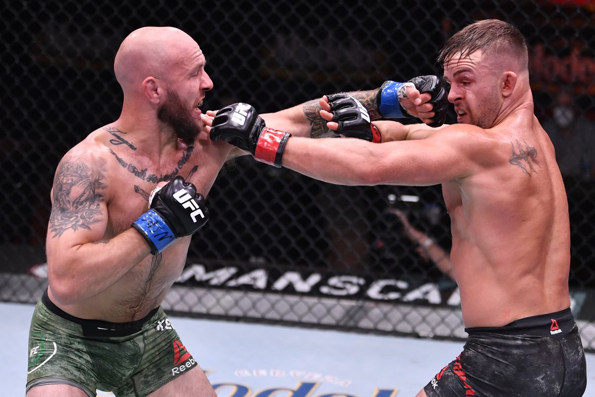 Brian Kelleher punches Cody Stamman in their featherweight bout during the UFC 250 event at UFC APEX on June 06, 2020 in Las Vegas, Nevada.