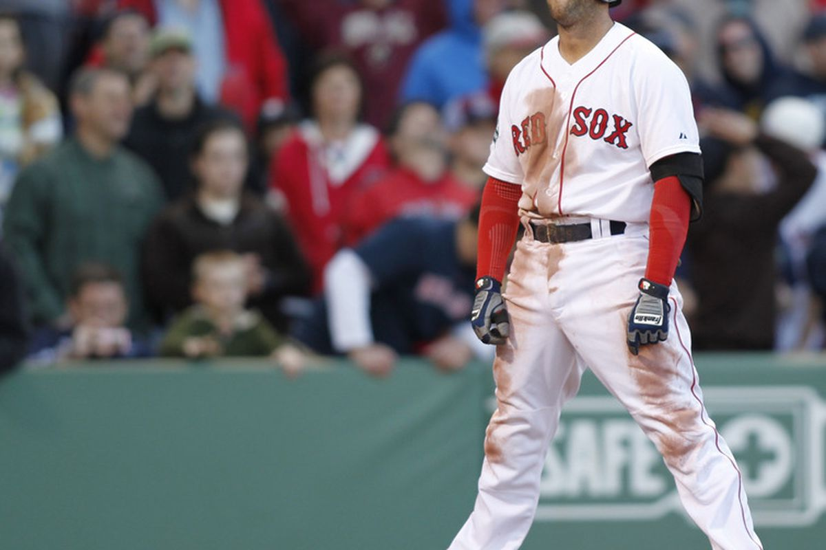 May 6, 2012; Boston, MA, USA; Boston Red Sox second baseman Dustin Pedroia (15) reacts to striking out during the fifteenth inning against the Baltimore Orioles at Fenway Park.  Mandatory Credit: Greg M. Cooper-US PRESSWIRE