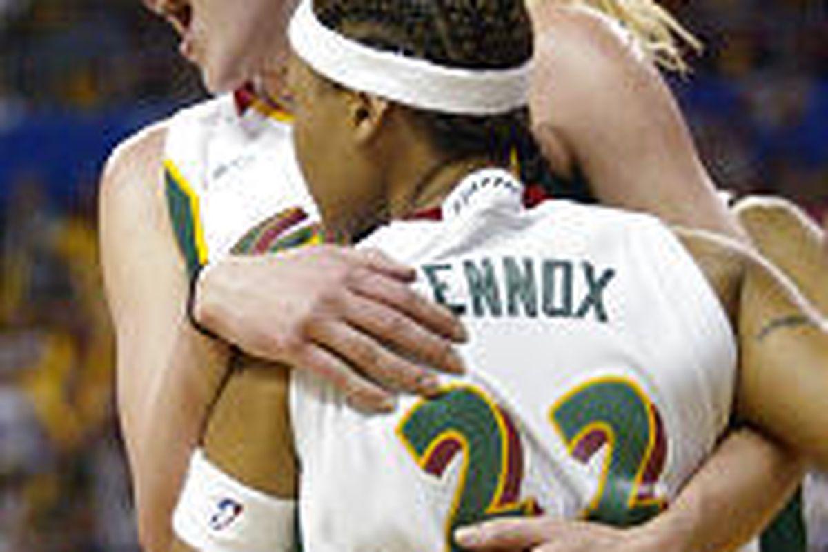 Seattle's Lauren Jackson, left, hugs Betty Lennox after Lennox scored a basket and drew a foul against the Connecticut Sun on Sunday.