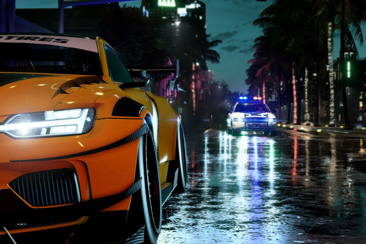 a yellow Volvo sports car with a Ford police car tailing it in a rainy nighttime scene in Need for Speed Heat