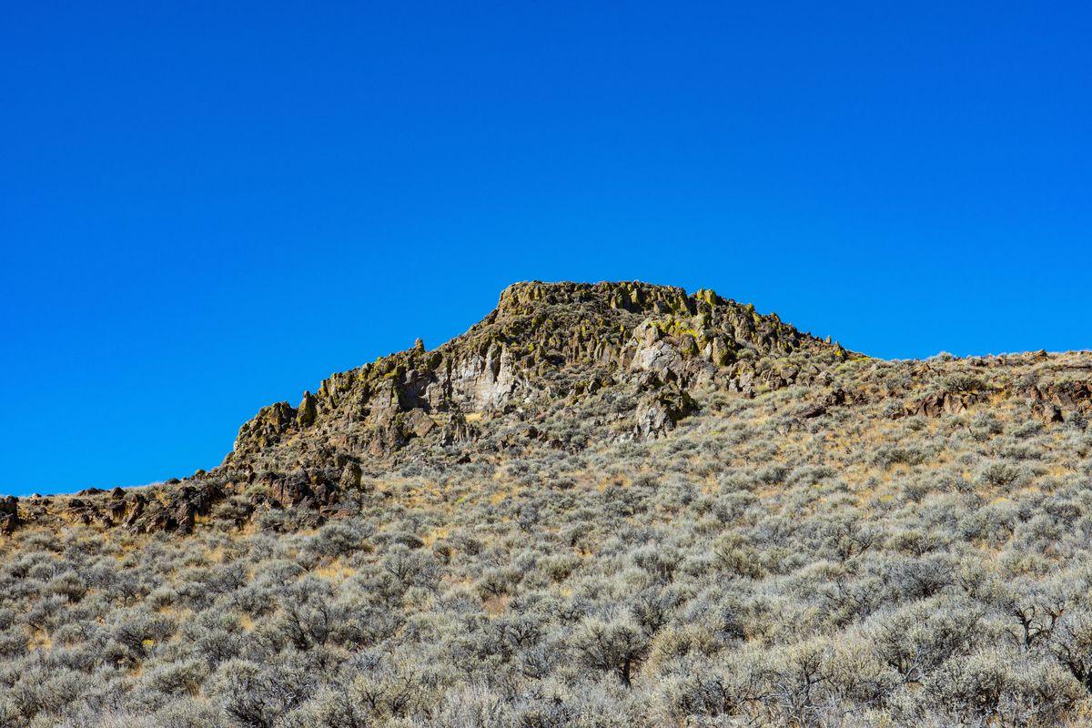 California, Black Rock Desert, Rocky Butte Framed by Sagebrush