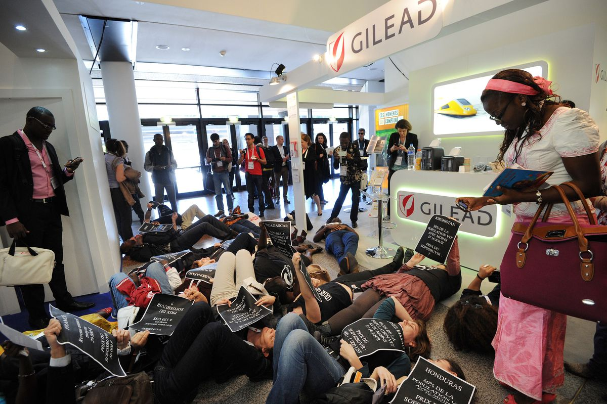 Protesters host a sit-in at Gilead, the French pharmaceutical company that makes Harvoni, to protest the high prices (Getty Images)