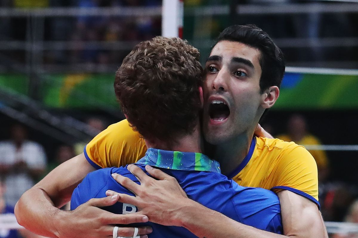 Douglas Souza celebrates winning the 2016 volleyball gold medal with a teammate.