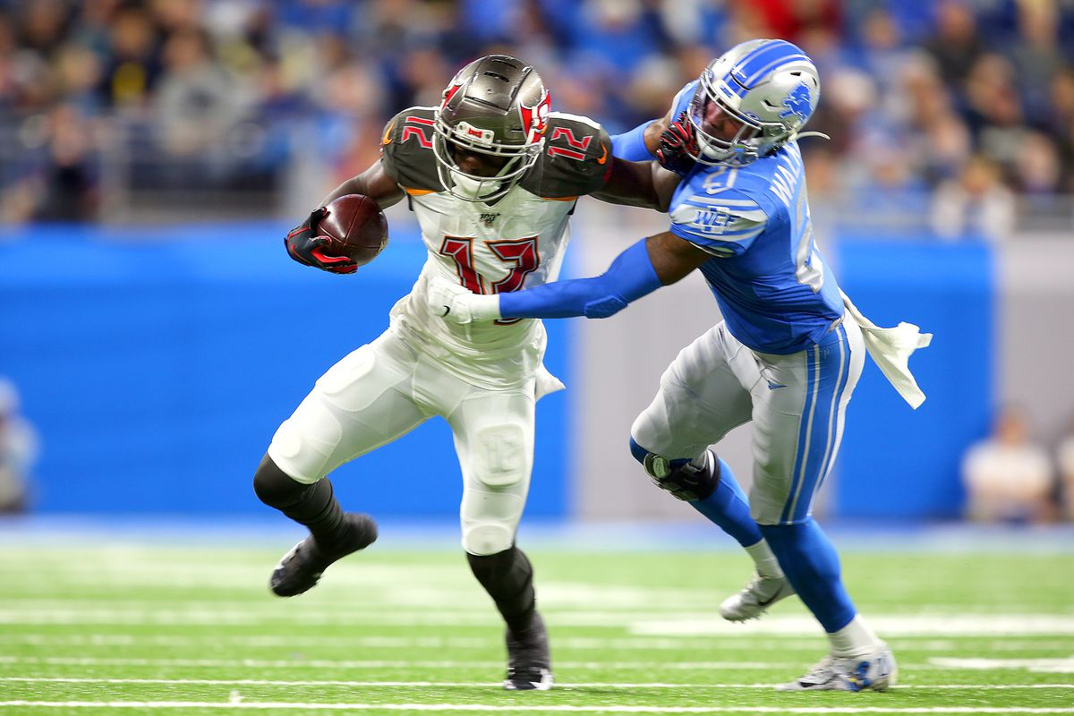 Tampa Bay Buccaneers wide receiver Chris Godwin runs the ball under the pressure of Detroit Lions defensive back Tracy Walker during the first half of an NFL football game against the Detroit Lions in Detroit, Michigan USA, on Sunday, December 15, 2019.