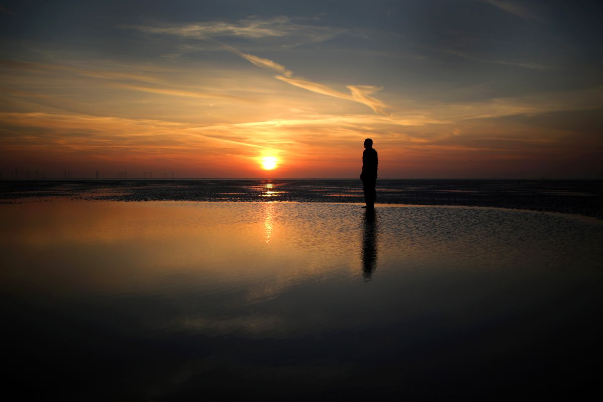 Antony Gormley's 'Another Place' At Sunset In Crosby