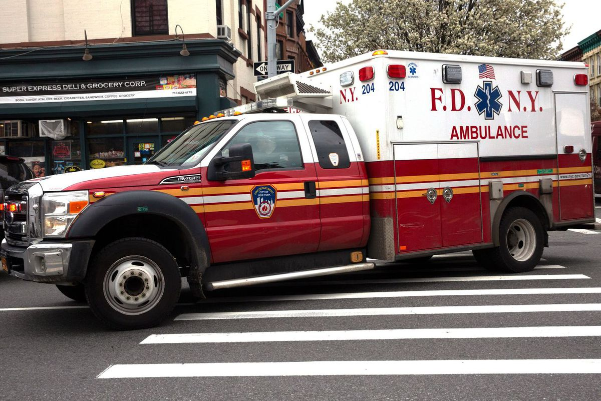 An FDNY ambulance rushes through Bed-Stuy during the coronavirus outbreak, March 31, 2020.